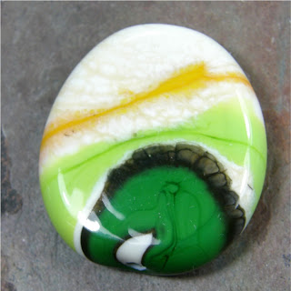 https://www.artfire.com/ext/shop/product_view/Covergirlbeads/4160075/Green_Lime_Apricot_Ivory_Craze_Lampwork_Glass_Focal_Bead_Black_Webs/Jewelry/Handmade_Jewelry_Supplies/Lampwork