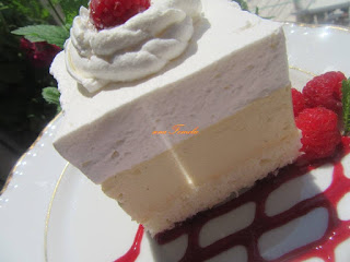 Creamy cake with raspberries