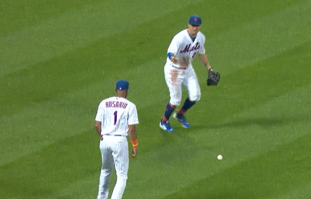 Mets shortstop Amed Rosario and LF JD Davis lose ball in lights