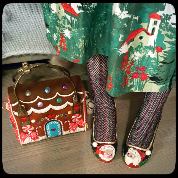 wearing Irregular Choice Christmas shoes with festive handbag and metallic fishnet tights