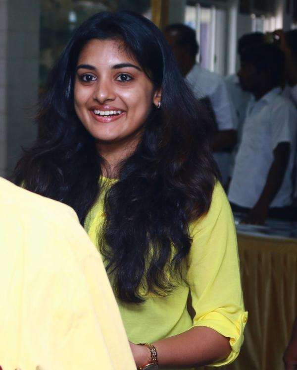 Glamorous Niveda Thomas Photos In Yellow Dress