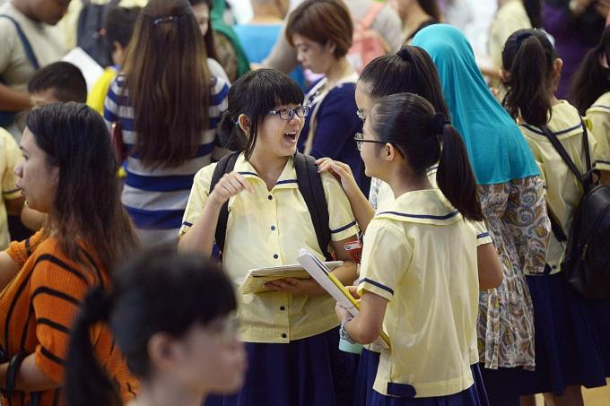 Students getting their PSLE results yesterday at Lakeside Primary School. 98.4% of PSLE pupils qualify for secondary school.