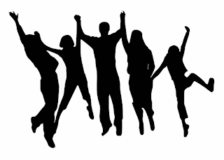silhouette of 5 people holding hands and jumping with arms raised