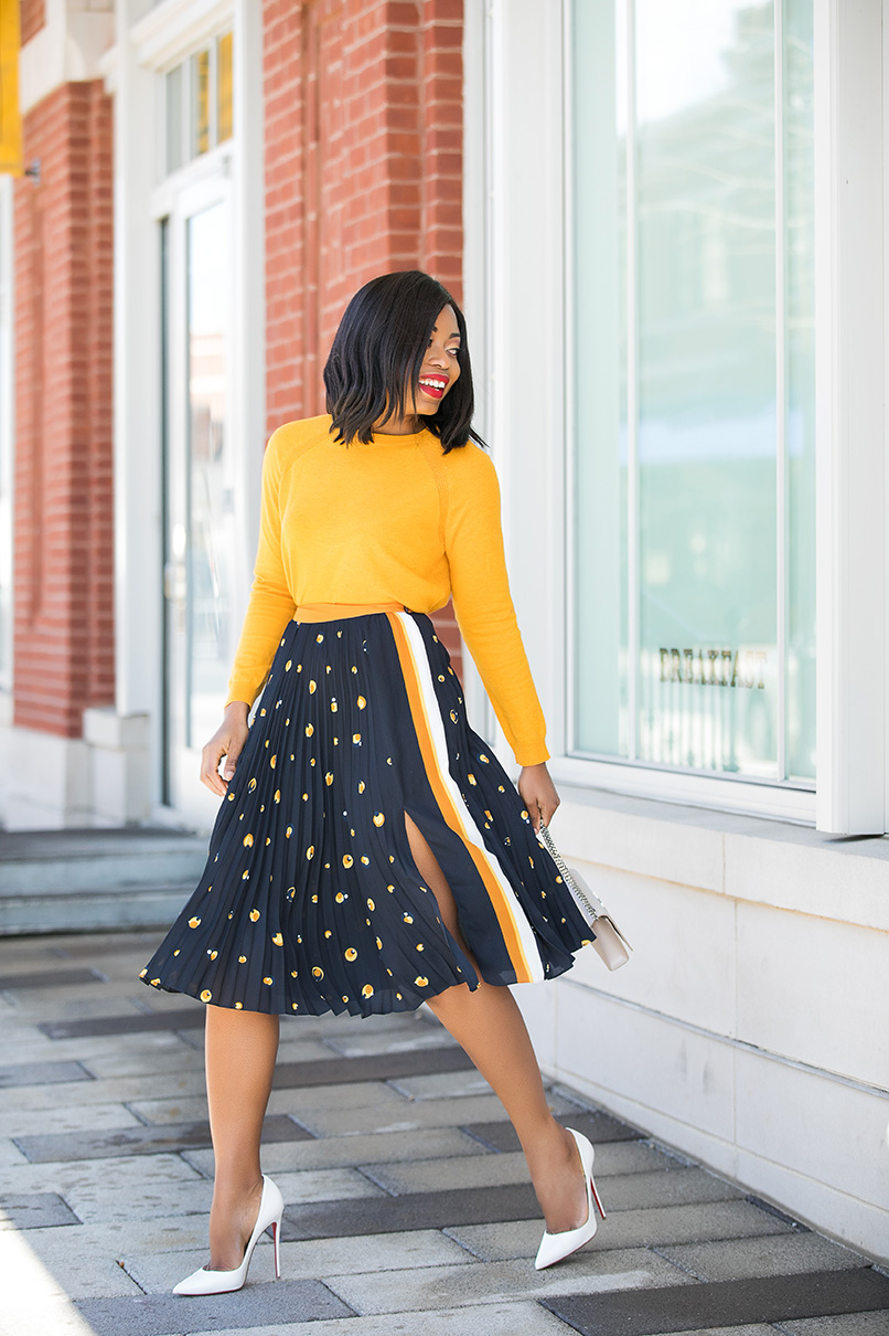 Stella-Adewunmi-of-jadore-fashion-shares-her-work-style-in-midi-skirt