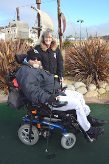Terry and Karen Avery trialling the mobility-friendly putters on the Pirate Adventure Golf course in Hastings