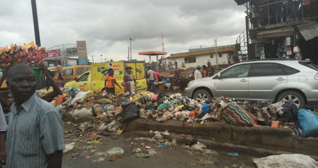 garbage filled road ikotun lagos
