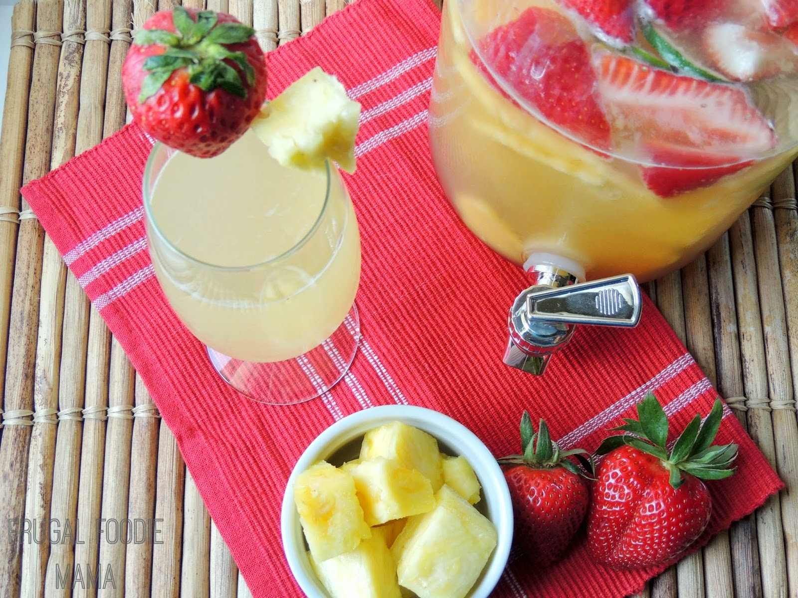 "This fruity & bubbly Strawberry-Pineapple ""Sans""gria is the perfect kid friendly drink to serve for a spring brunch or summer BBQ! Adults can add a splash of white wine or rum."