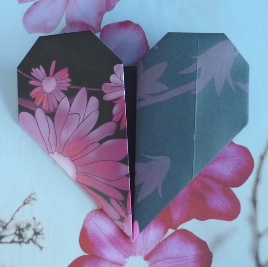 Paper folded origami heart shape in black and purple floral paper