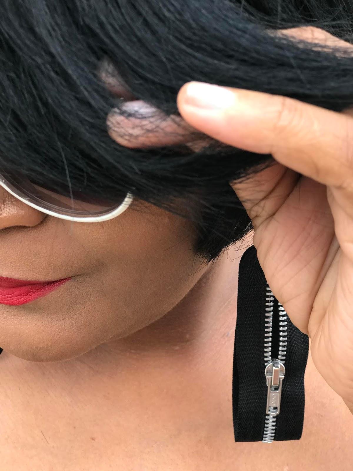 Image: Woman wearing zipper earrings