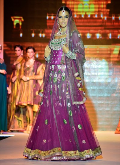 Neha Dhupia walks the ramp for PC jewelers at IIJW 2014