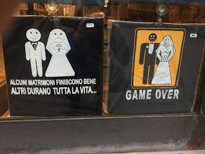 T-shirt shop: commentary on some marriages.