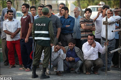 People watching a public hanging in Iran.