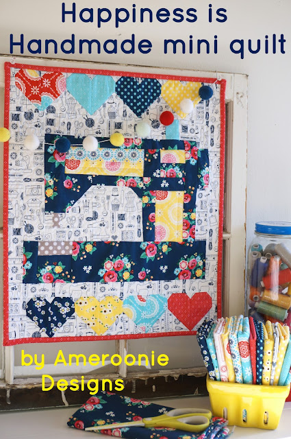 mini quilt featuring sewing machine