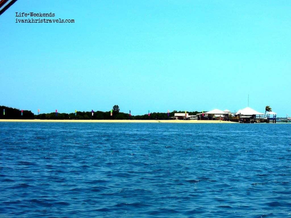 Honda Bay Island Hopping Tour Luli Island from afar