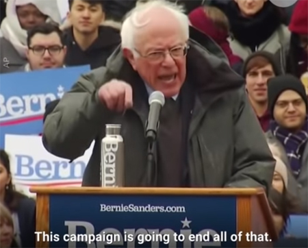 image of Bernie Sanders at a rally, gesticulating and looking angry
