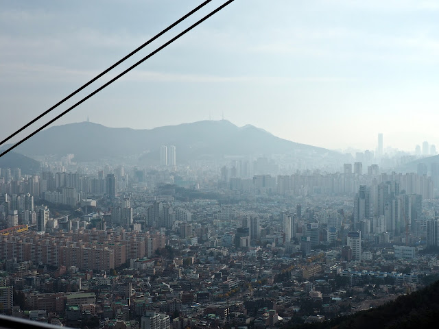 Views of Busan from Geumgang cable car, going up Geumjeongsan Mountain, Busan, South Korea
