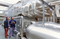 Maintenance workers view air conditioning pipes, Hospital Donostia, San Sebastian, Spain, 23/03/2015. (Credit: age fotostock / Alamy Stock Photo) Click to Enlarge.