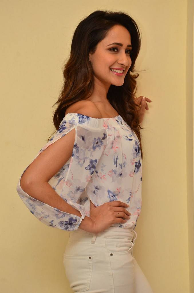 Telugu Girl Pragya Jaiswal Long Hair Stills In White Top Jeans