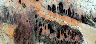 brigands houses,abstract landscapes of deserts of Africa ,Abstract Naturalism,abstract photography deserts of Africa from the air,abstract surrealism,mirage in desert,abstract expressionism,