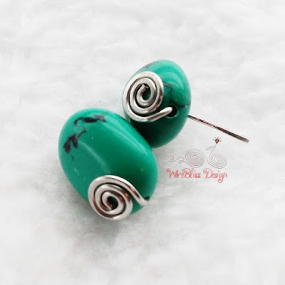 Simple Turquoise wire wrapped earrings with small swirls in front