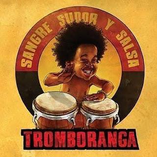 Black boy playing bongos