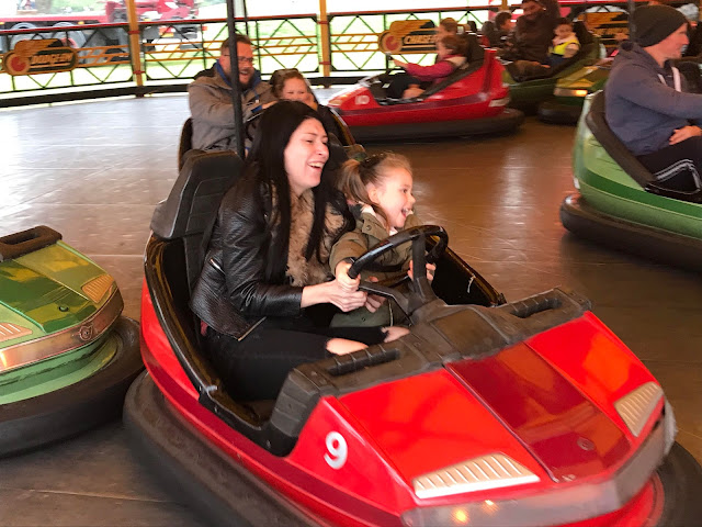 My niece and her mum laughing on the Carters Steam Fair dodgems ride.