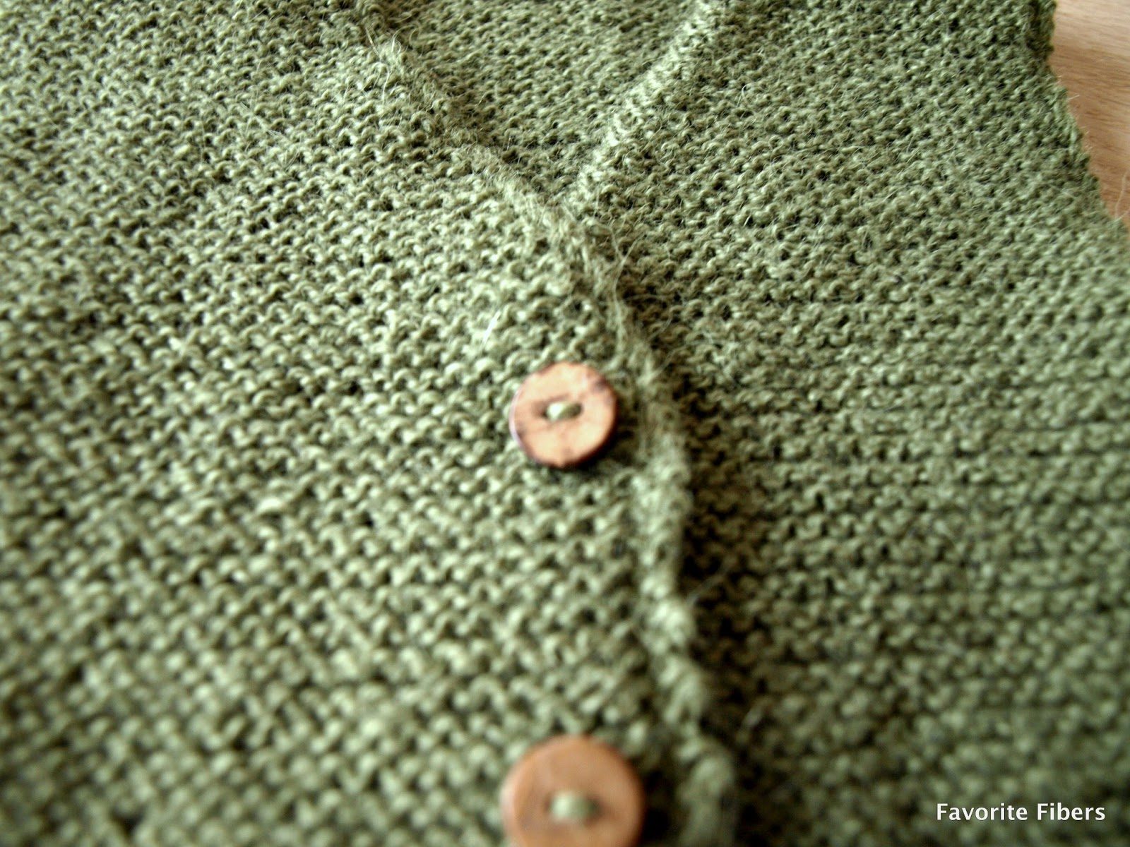 49560064582e4a Newest item is this little garter stitch vest with the cutest buttons -  same buttons as I used for these pants.