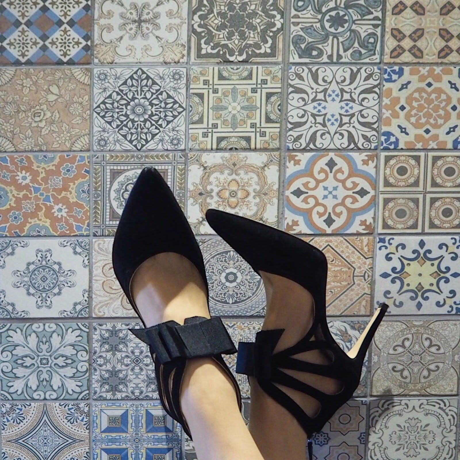 High heeled bow shoes by Boden, tiled wall at Beck Hall hotel, Malham