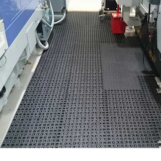 Greatmats Wearwell ErgoDeck Open perforated tile mats installed