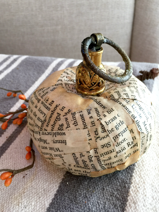 Newsprint fall decor pumpkins and gourds with vintage metal stems. Homeroad.net