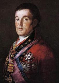 Vestido con uniforme de general, guerrera roja luciendo varias condecoraciones españolas.