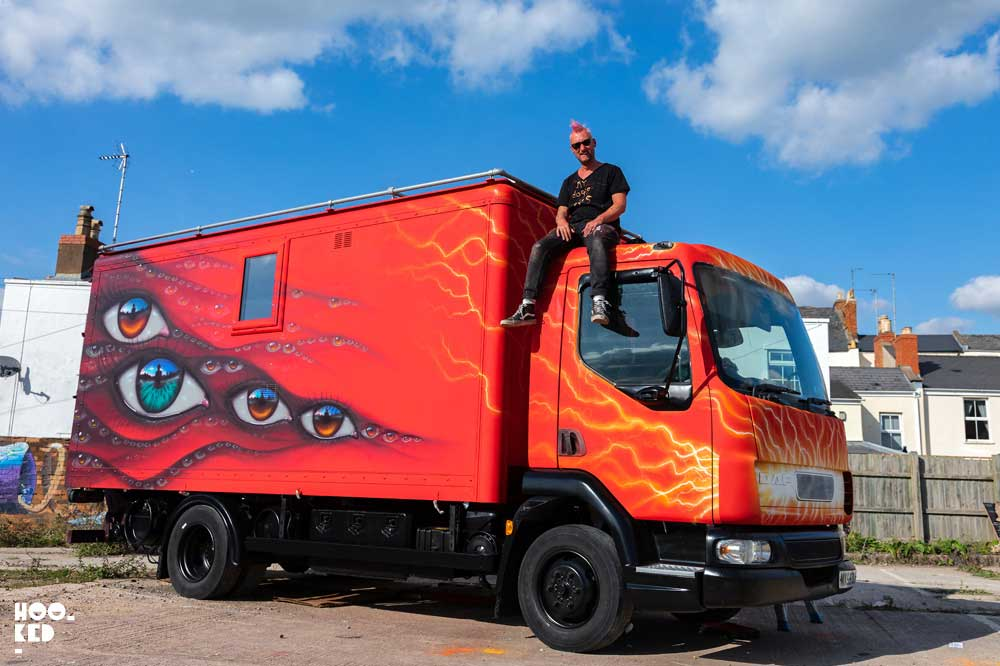 Street Artist My Dog Sighs in paints a truck in Cheltenham, UK as part of the Cheltenham Paint Festival