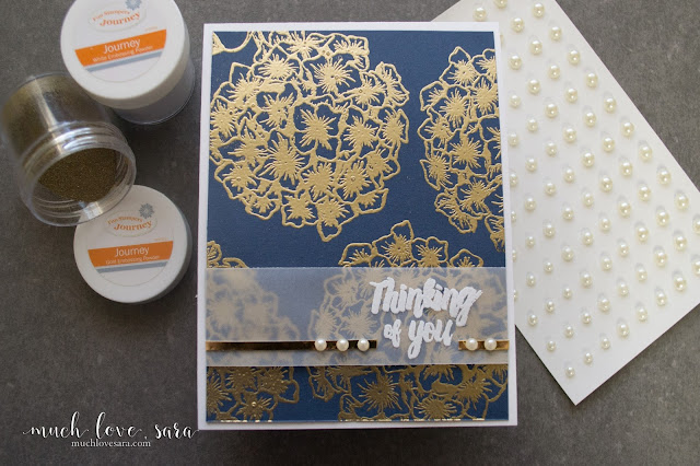 The Bloom Burst Stamp Set, from Fun Stampers Journey, is gorgeous heat embossed in gold against a dark blue background.   This simple, elegant, handmade, Thinking of you card comes together quickly.