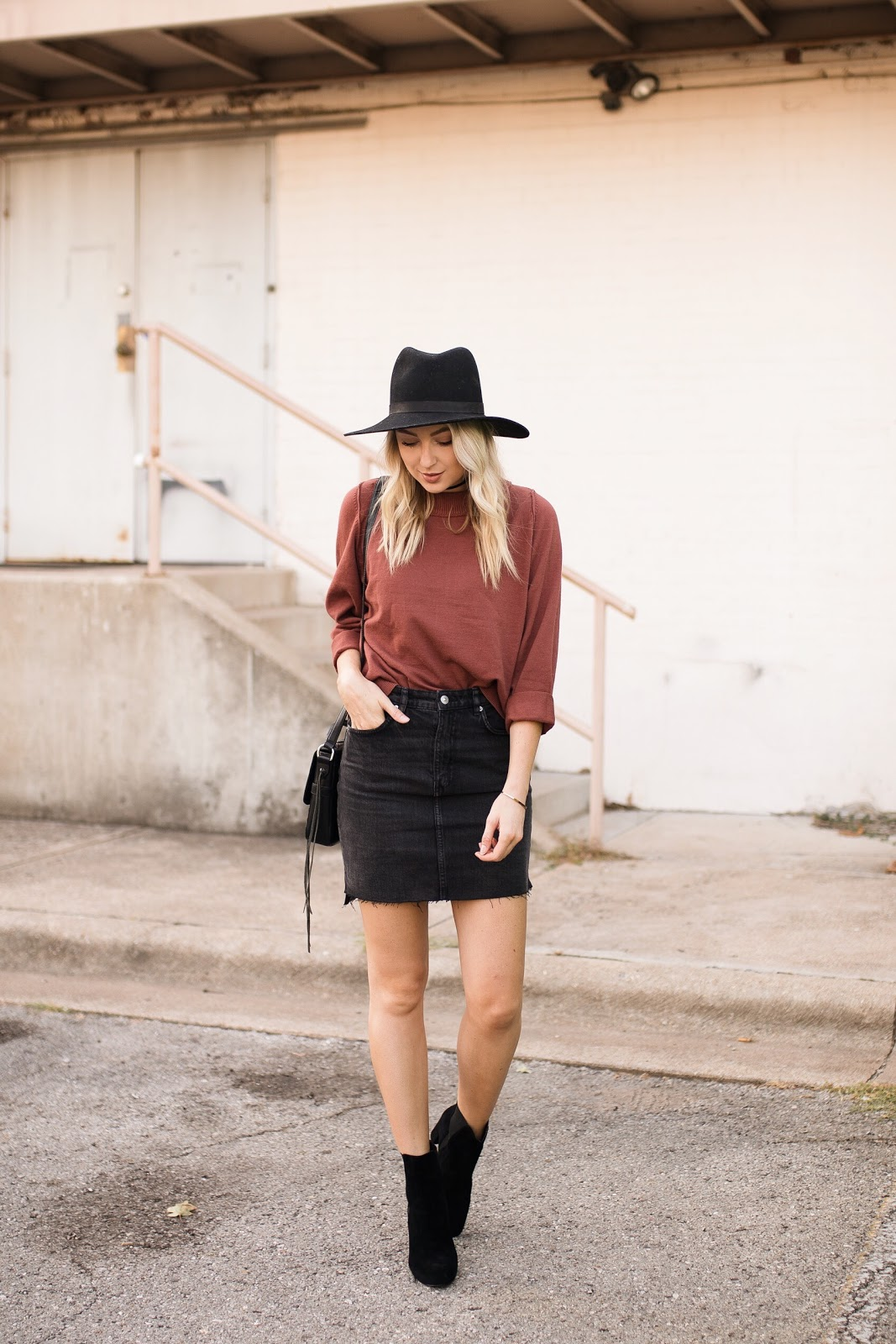 sweater with a denim mini skirt and ankle boots