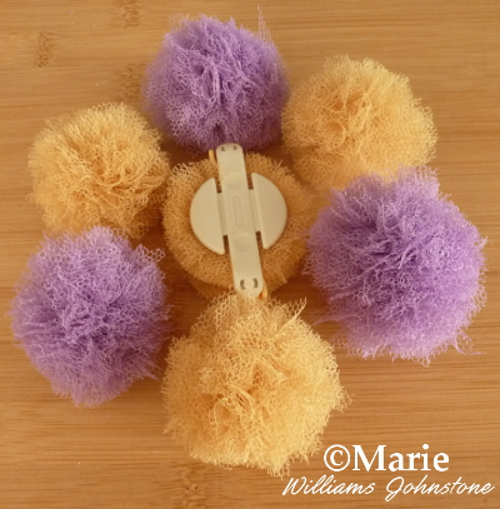 Completed set of lilac and yellow tulle pom poms netting fabric material