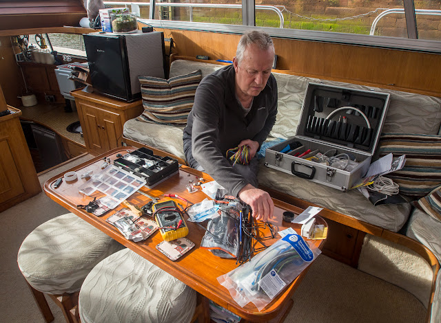 Photo of Phil sorting his electrical stuff in Ravensdale's saloon