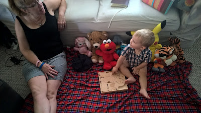 toddler and grandma playing picnic with stuffed animals