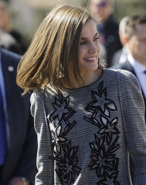 Queen Letizia wore Carolina Herrera Prince Of Wales Floral Cutout Dress, Hugo Boss Cegina coat, Lodi pumps, Coolook Hera Earrings