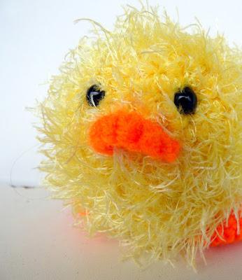 Crochet amigurumi little yellow fluffy chick