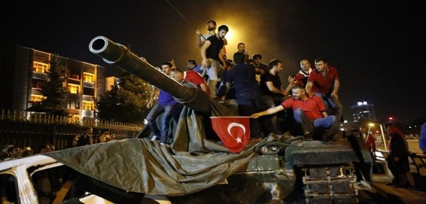 Turkish riot police escort a soldier, center, who allegedly took part in a military coup in Istanbul