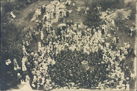 A black and white photograph of a crowd from above.