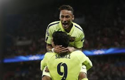 Suarez carrying Neymar after scoring