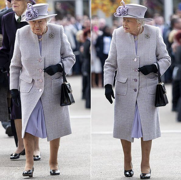 The Queen wore a pastel purple dress which featured a knee-length pleated skirt and a long quilted coat with three layers of pearls necklece