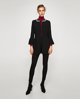 A strriking black frock coat embellished with a pearl collar from Zara