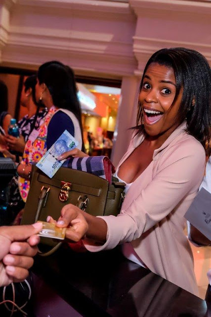 Tsogo Sun Rewards -  Katlego Mohaoduba handing over her Tsogo Sun rewards card for more benefits