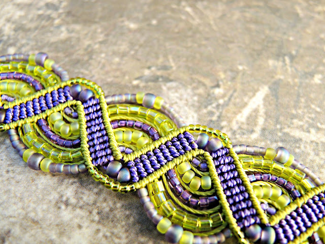 Beaded macrame bracelet in green and purple.