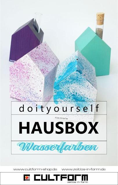 Die Hausbox von Cultform. Ein eindrucksvolles und doch einfaches DIY: kleine Geschenke individuell modern verpacken im aktuellen Watercolor-Trend. Pingrafik mit Text, Lila, Azur