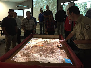 Javier Vara Sanz demonstrates the simulation table in the Emergency Operations Center; photo credit: Jessica Jackson