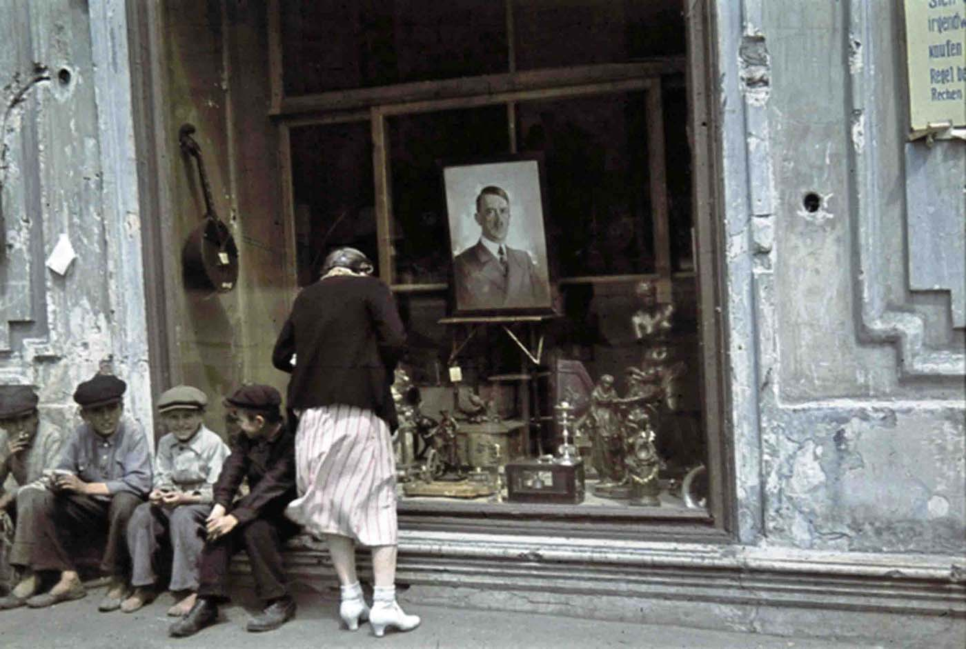Portrait of Adolf Hitler in a shop window.