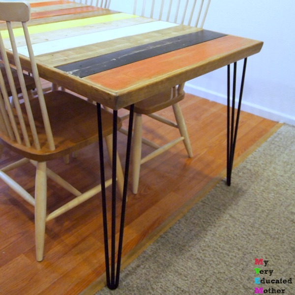 Ignore the horrible flooring (the new stuff is coming soon) and focus on those awesome hairpin legs on a DIY pallet wood table!